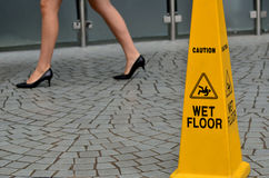 Slippery floor surface warning sign. And symbol in building, hall, office, hotel , restaurant, restroom. Concept photo danger Royalty Free Stock Photos