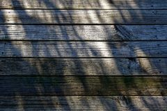 A slippery looking wooden deck royalty free stock photography