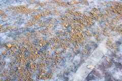 A slippery pavement covered with sand. As an antiskid stuff Stock Images
