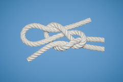 Slippery Reef Knot. It is a knot used to attach a line to a rod or a bar Royalty Free Stock Photo