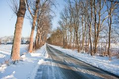 Slippery road in frozen Dutch farmland Royalty Free Stock Photo