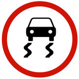 Slippery road sign board. Traffic Stock Image