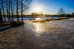 Slippery slope and bright sun in city. Spring concept royalty free stock photography