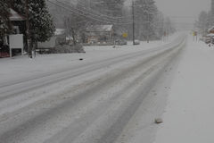 Slippery snow covered road Stock Images