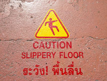 Slippery warning in thai Royalty Free Stock Photo