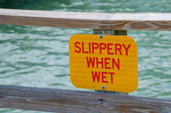 SLIPPERY WHEN WET dock sign Stock Images