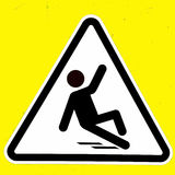 Slippery wet floor sign. Symbol Stock Photos