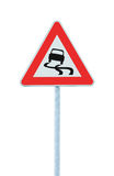 Slippery when wet road sign, isolated signpost pole post and traffic signage Stock Photos