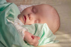 Slipping baby Stock Images