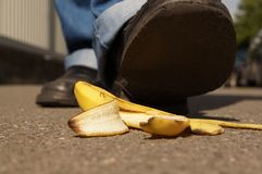 Slipping on a banana peel. Person about to slip on a banana peel or banana skin Stock Photo