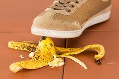 Slipping on a banana skin Stock Image
