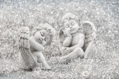 Slipping guardian angel with christmas decoration Stock Image