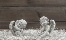 Slipping guardian angel with shiny christmas decoration Royalty Free Stock Photo