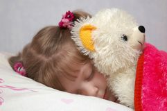 Slipping with toy. A little girl sleeping with a toy Stock Images