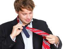 Slips - mannen kan inte binda hans tie arkivfoto