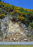 Slips & Rock Slides line Highway One south of  Kaikoura, NZ. Stock Photo