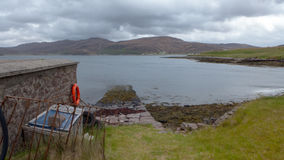 Slipway leading to a remote island`s croft. A slipway leading to a remote island`s croft in a remote Scottish island Stock Photo