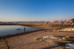 Slipway Rowing Oars Canoe Regatta. Athlete skull rowing canoe going off slipway with canoes and oars into the water Royalty Free Stock Photography