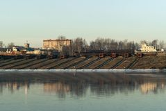 Slipways of ship repair yard for river ships. Slipways with roller-pallets of ship repair yard for river vessels on the shore of the winter canal royalty free stock photos