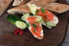 Slised Freshly Baked Baguette with Smoked Salmon on Wooden Board Stock Image