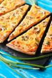 Slised vegeterian home made pizza mushrooms on blue table Stock Images
