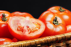 Slit tomato in basket closeup Royalty Free Stock Images