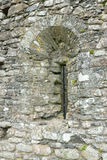 Slit window in stone. Window in Lydford Castle circa 1195. Initially built as a prison to house local convicts, it was subsequently restructured as a Castle Royalty Free Stock Photography