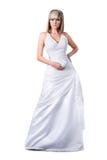 Slitage bröllopsklänning för säker blond brud Arkivbild