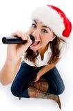 slitage för karaoke för julhattholding model Arkivbild