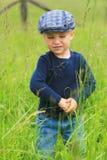 slitage för litet barn för plant gräs för lock högväxt Arkivbild