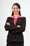 slitage kvinna för härlig älskvärd leendedräkt för affär Arkivbild