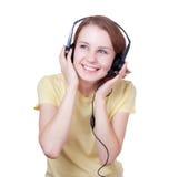 slitage kvinnabarn för lycklig hörlurar med mikrofon Royaltyfri Fotografi