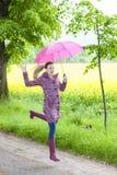 Slitage rubber kängor för kvinna Arkivfoto