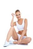 Slitage vit underklädersitting för härlig kvinna Royaltyfria Bilder