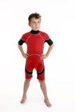 slitage wetsuit för barn Arkivbild