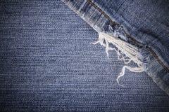 Sliten jeanstextur för bakgrund Royaltyfri Foto