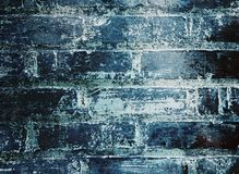 Sliten tegelstenvägg fotografering för bildbyråer