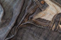 Slitet mörker - jeans Arkivbild