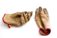Slitna och red ut handskar Arkivbild