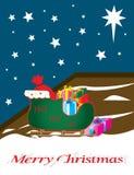 Slitta della Santa in pieno dei regali, parte esterna, su uno starlit Fotografia Stock