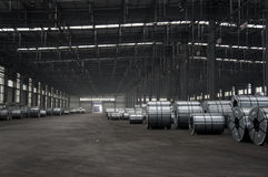 Slitted Coils Stored for manufacturing. Warehouse with slitted steel coils (Hot Rolled / HR and Cold Rolled CR) of virgin grade. The coils are cut to length and royalty free stock photo