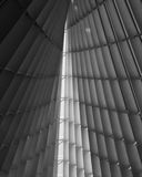 Sliver of light in steel and glass. Sliver of light in the architectural details of steel and glass building interior royalty free stock photography