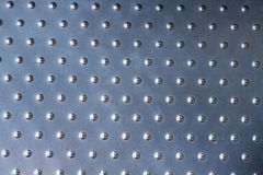 Sliver metal plate with many small circular dot. Royalty Free Stock Photography