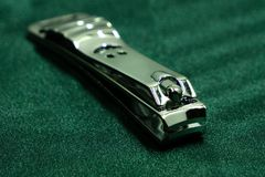 Sliver nail clipper green salon cosmetics cuticle.  stock images