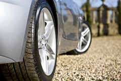 Sliver Sports Car. On driveway stock photography