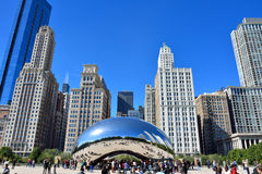 Slivery Bean sculpture and city buildings, Chicago. Famous Chicago Millennium Park and Slivery Bean sculpture, Photo taken in October 6th, 2014 Royalty Free Stock Photos