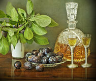 Slivovitz bottle and plums Stock Photography
