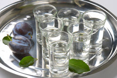 Slivovitz and plums Royalty Free Stock Photography