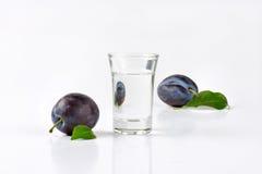 Slivovitz and plums Stock Photo