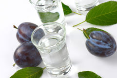 Slivovitz and plums Royalty Free Stock Images
